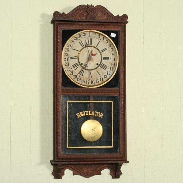 1018: Circa 1900 calendar wall regulator clock, Gilbert