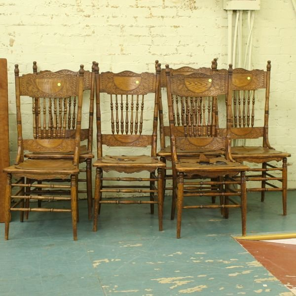 1024: Set of six circa 1900 pressed back dining chairs,