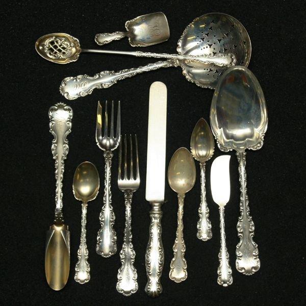 18: Set of 110 piece sterling flatware service, Whittin