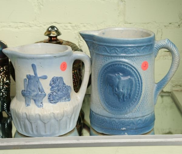 1003: Two circa 1900 stoneware pitchers, blue and white