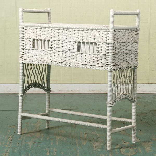 "1018: Wicker planter, woven sides and ends, 29""l 11""w 3"