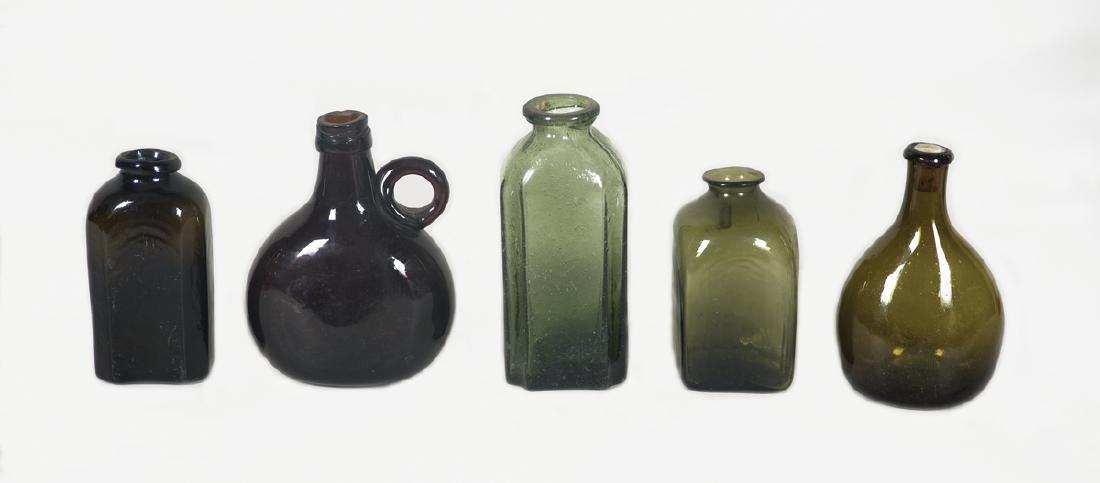 "FIVE 19TH C. BOTTLES Snuff in very dark olive, 4 1/2"" h;"
