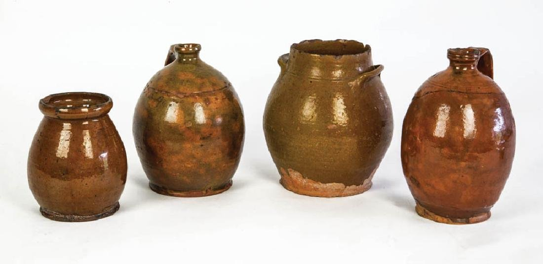 FOUR EARLY AMERICAN REDWARE PIECES Two ovoid crocks, 6
