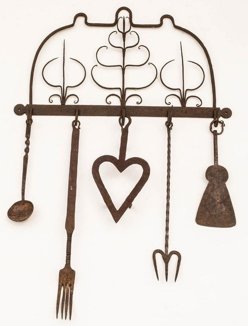COLLECTION OF WROUGHT IRON Hanger with decorative iron