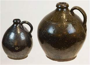 TWO EARLY REDWARE OVOID JUGSBoth jugs with dark