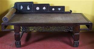 CHINESE OPIUM BEDCarved wood with dream stones in the