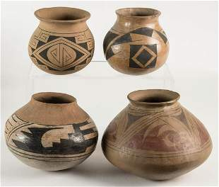 FOUR PUEBLO POTTERY JARSRed and brown geometric designs