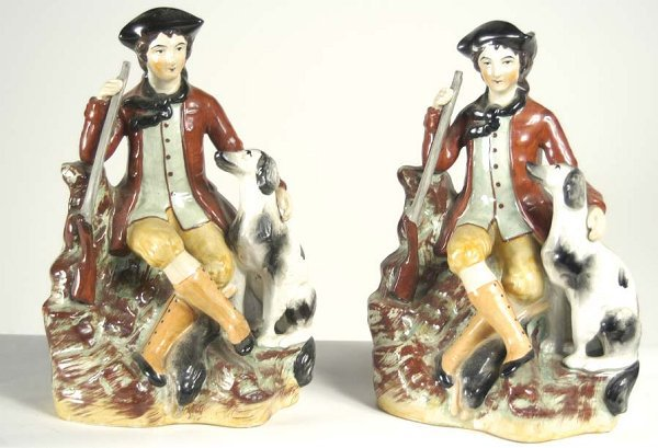 13: Pair of 19th c. Staffordshire figurines of a hunter