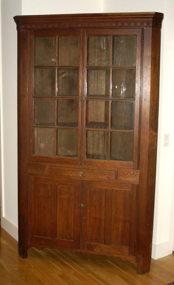 20: Late 18th c. walnut corner cupboard, molded cornice