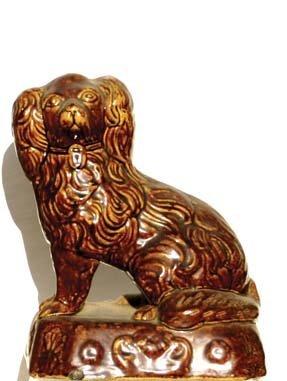 21: 19th c. Bennington pottery style mantle piece of a