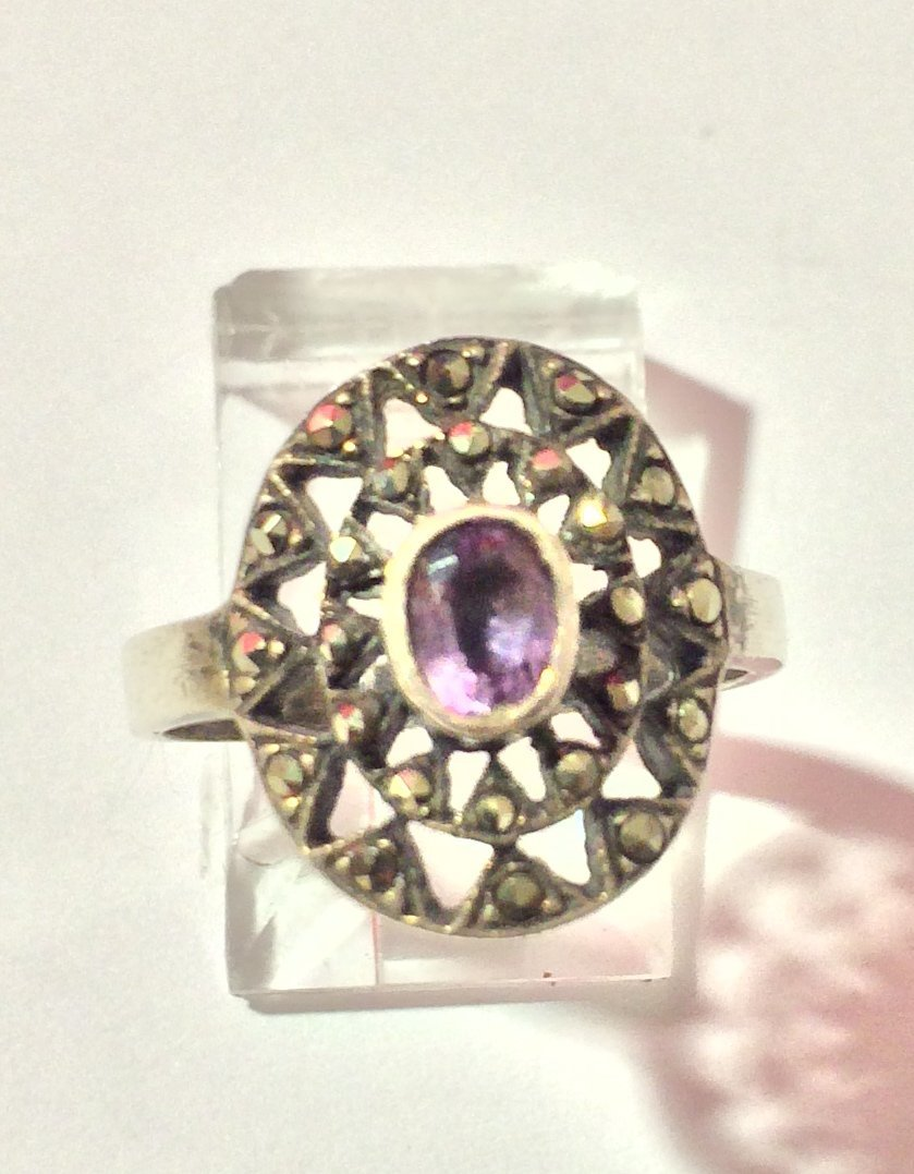 vintage siver ring with star and purple stone in center