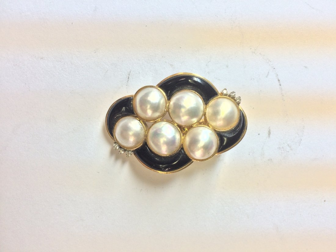 14kt yellow gold brooch with pearls, black enamel, and