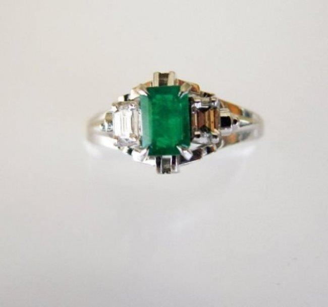 Emerald: .33CT, Diamond: .18CT, Ring Platinum