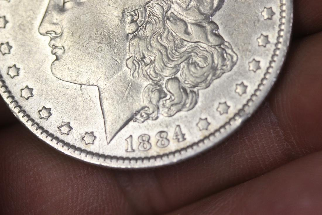 An 1884-O Morgan Silver Dollar - 6