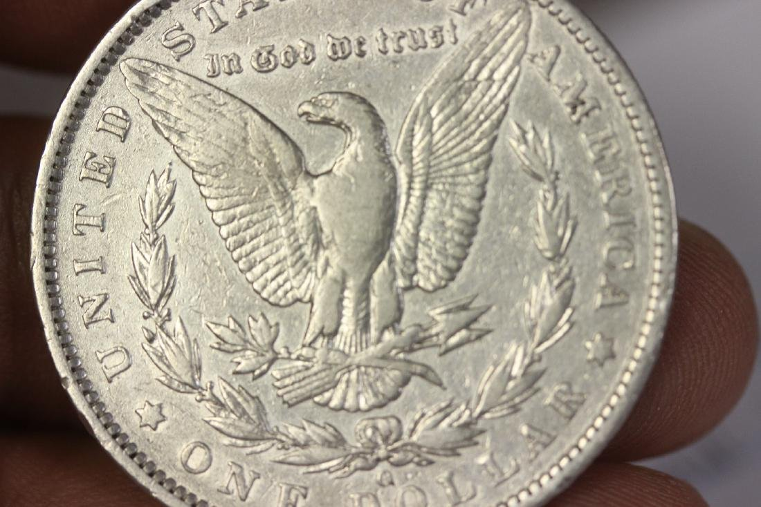 An 1884-O Morgan Silver Dollar - 7