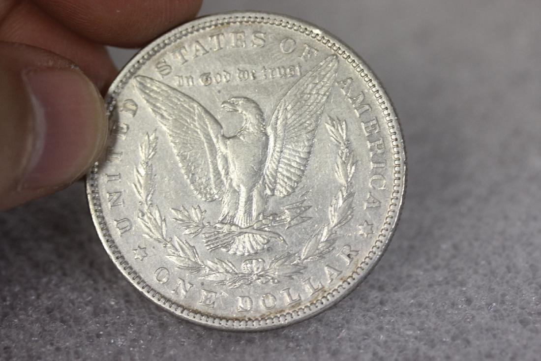 An 1882 Morgan Silver Dollar - 2