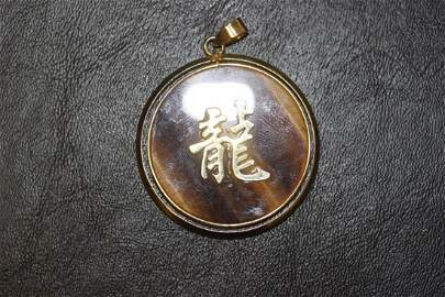 A Tiger Eye Pendant with Chinese Symbol
