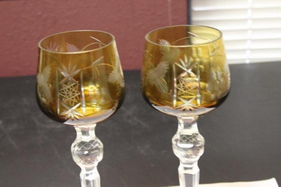 A Pair of Bohemian Cut Glass Amber Goblets