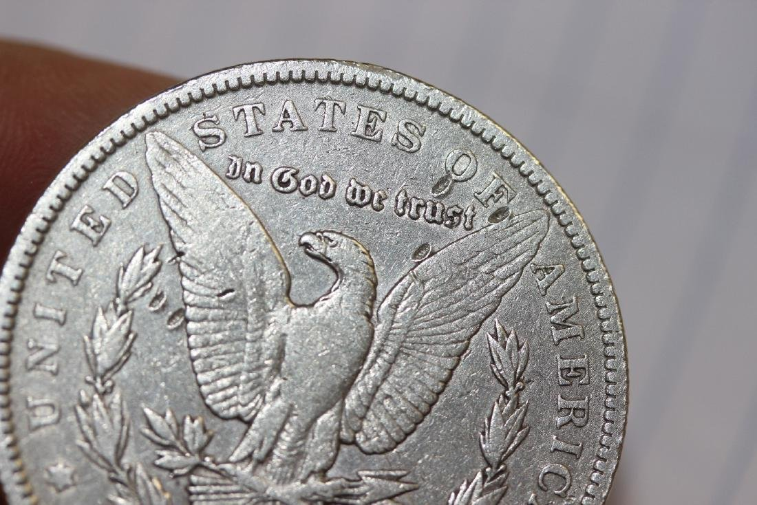 An 1886-O Morgan Silver Dollar - 4
