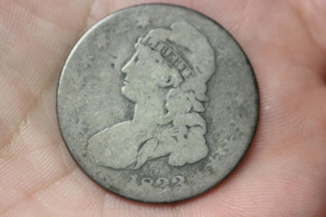 An 1833 Bust Hlaf Dollar