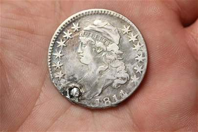 An 1814 Bust Half Dollar