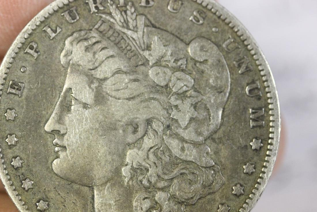 An 1887-O Morgan Silver Dollar - 6