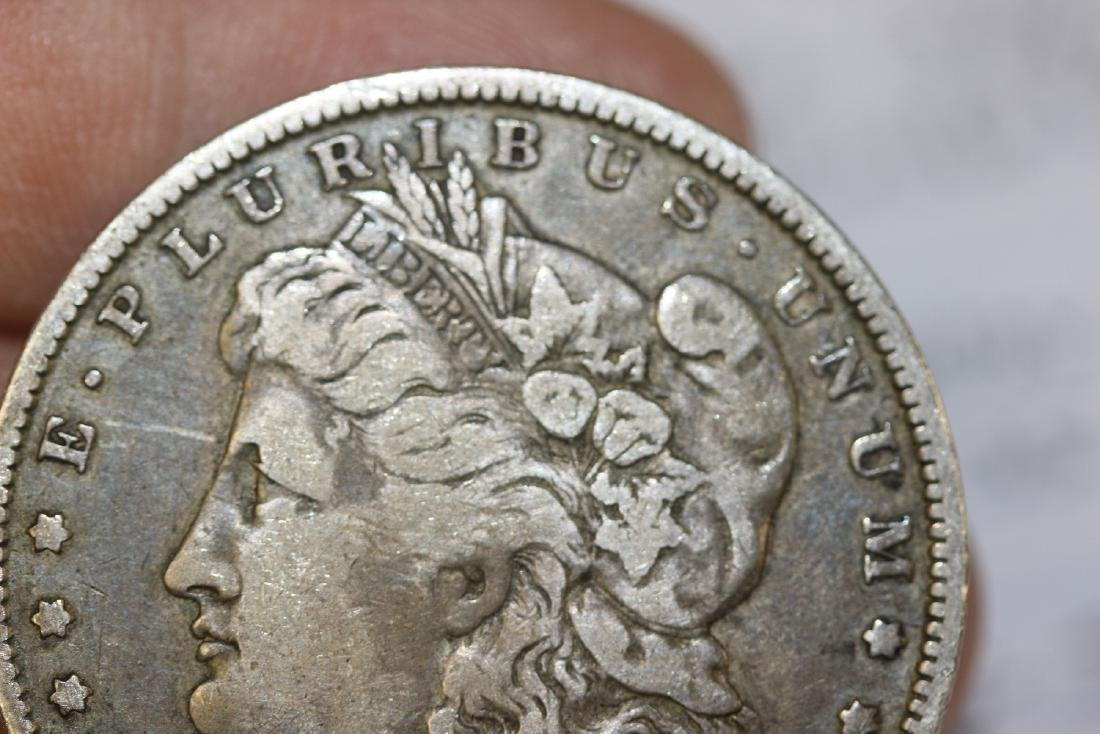 An 1887-O Morgan Silver Dollar - 7