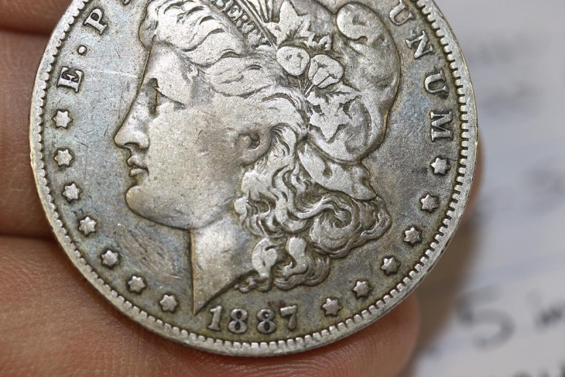 An 1887-O Morgan Silver Dollar - 8