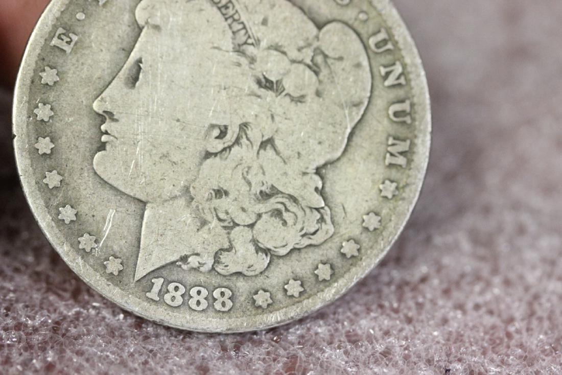 An 1888-O Morgan Silver Dollar - 6