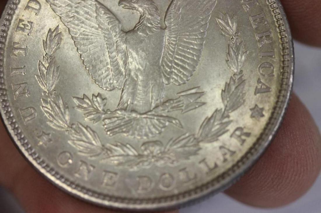 A 1903 Morgan Silver Dollar - 6