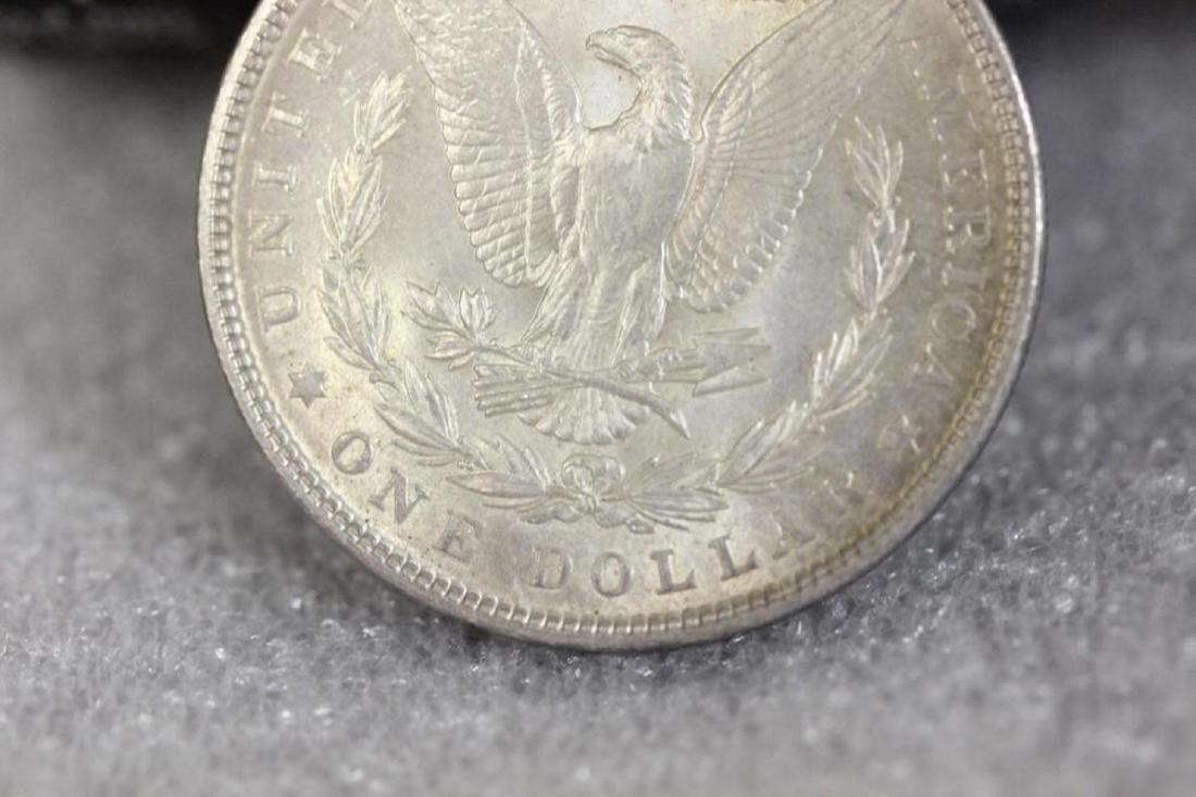 A 1903 Morgan Silver Dollar - 8