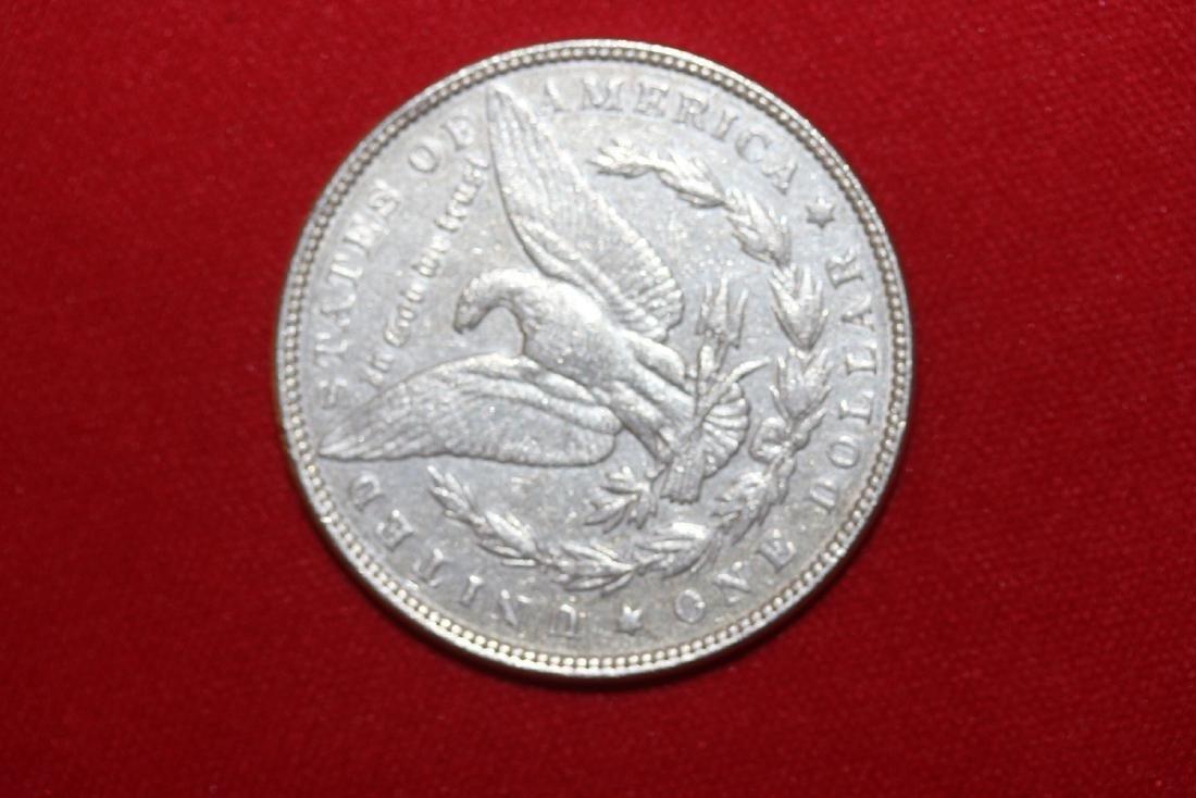 An 1897 Morgan Silver Dollar - 2