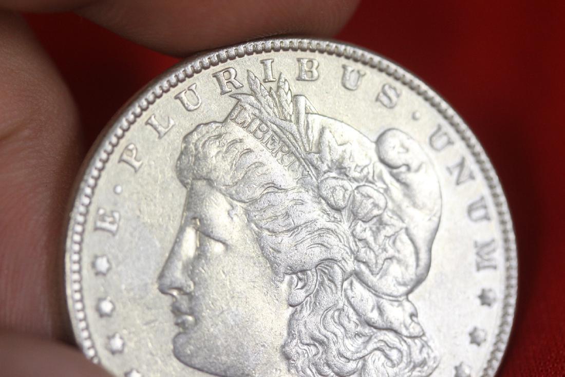 An 1897 Morgan Silver Dollar - 3