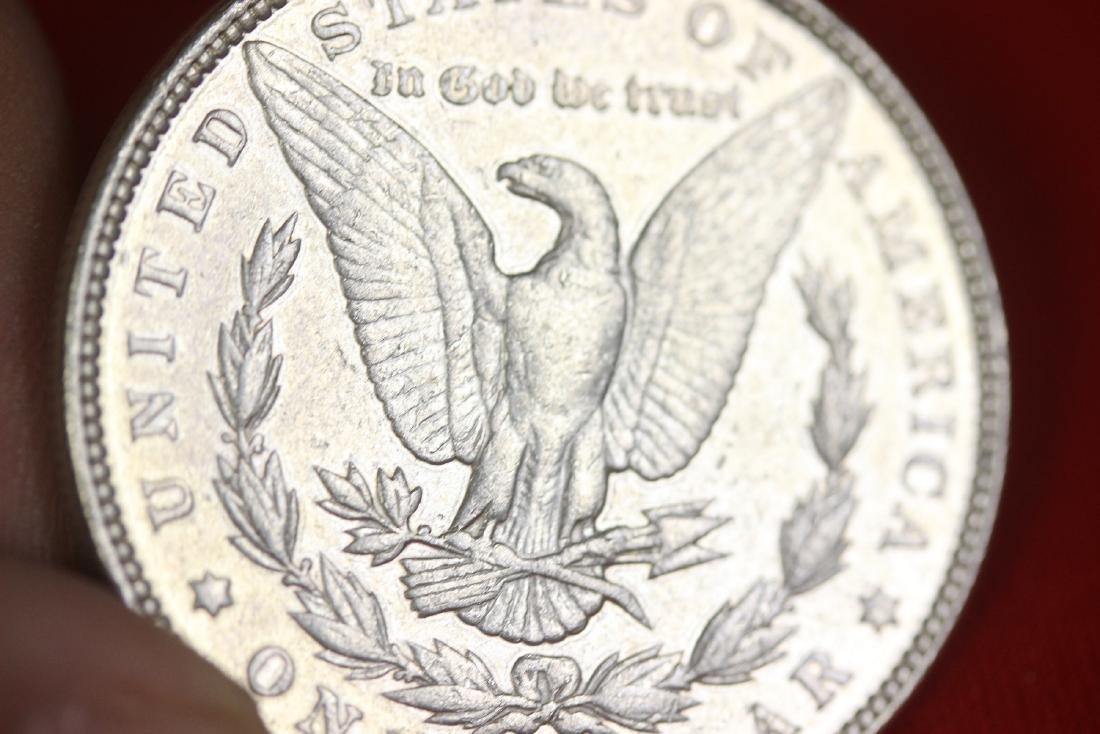 An 1897 Morgan Silver Dollar - 5