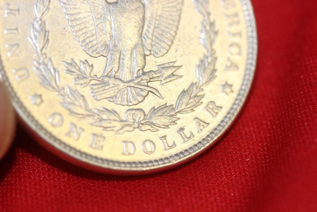 An 1897 Morgan Silver Dollar - 6