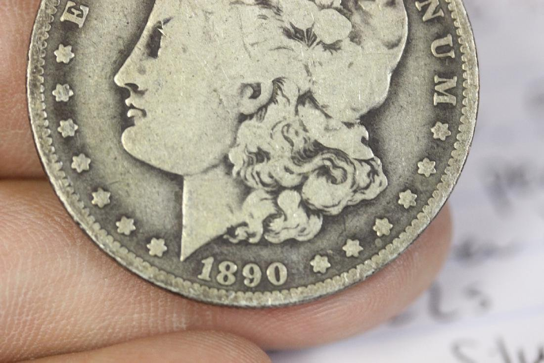 An 1890-O Morgan Silver Dollar - 8