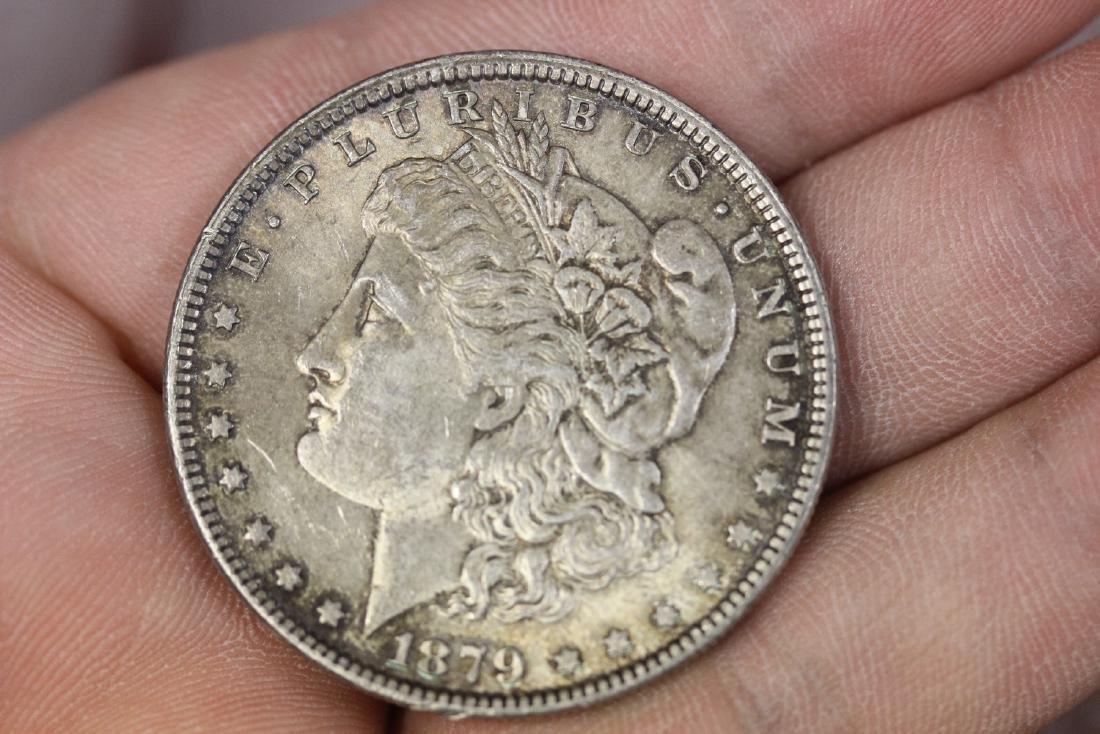 An 1879 Morgan Silver Dollar - 2
