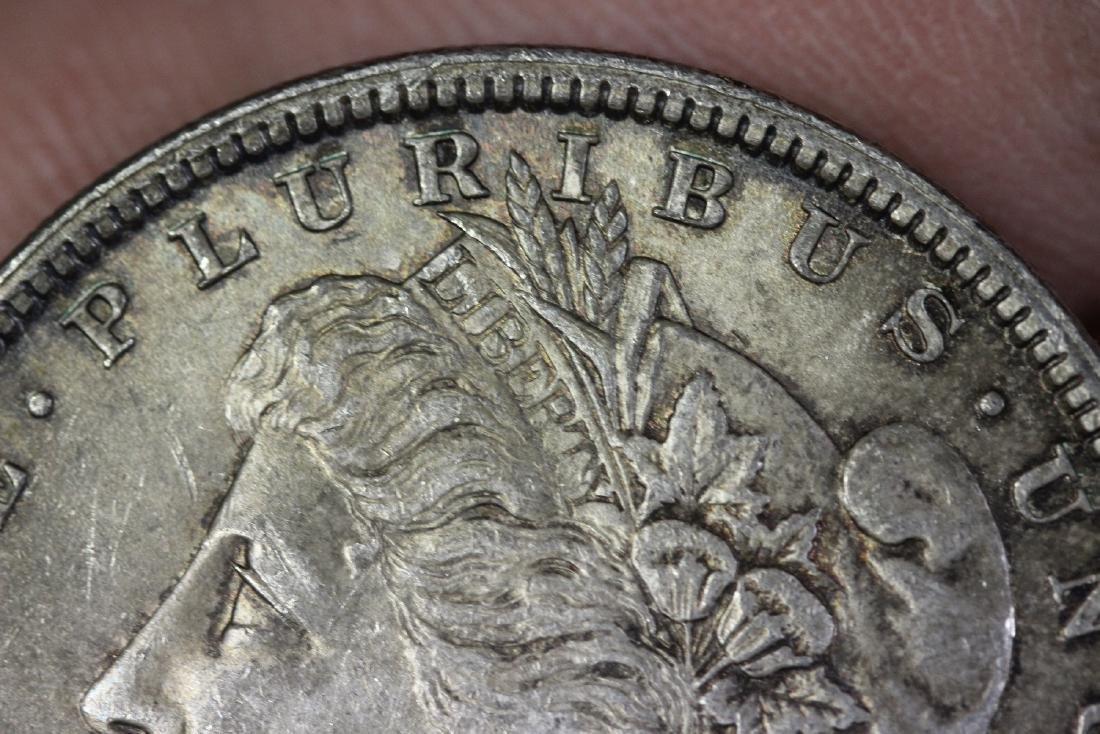 An 1879 Morgan Silver Dollar - 3