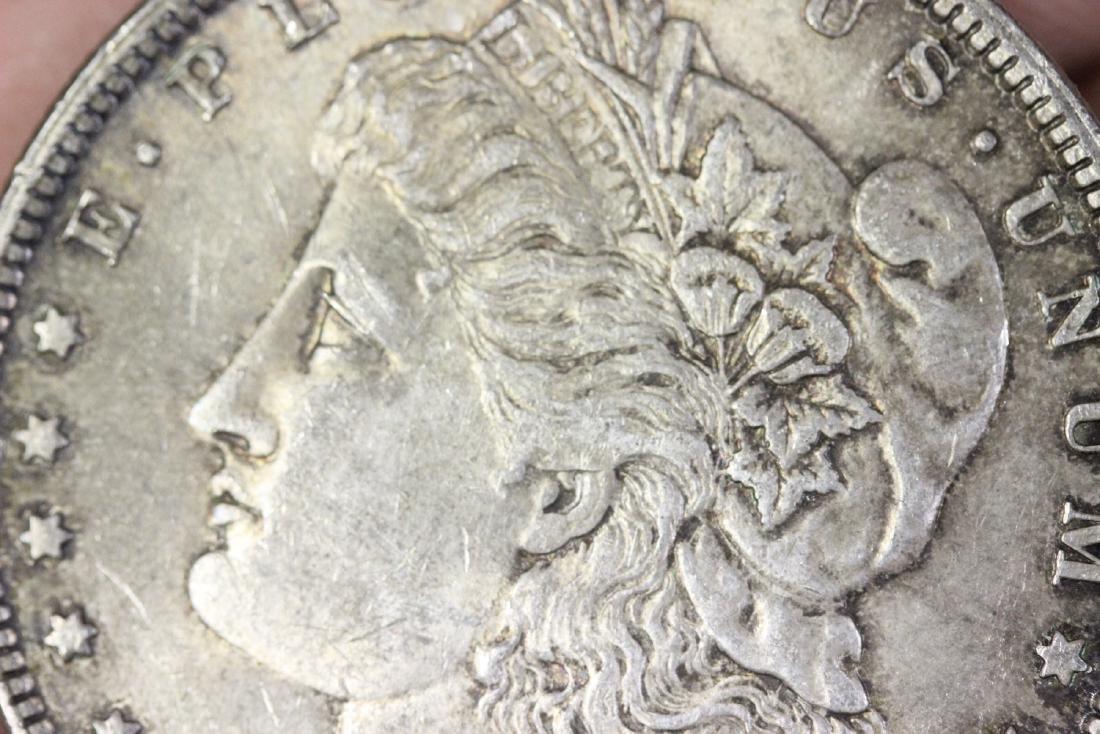 An 1879 Morgan Silver Dollar - 4