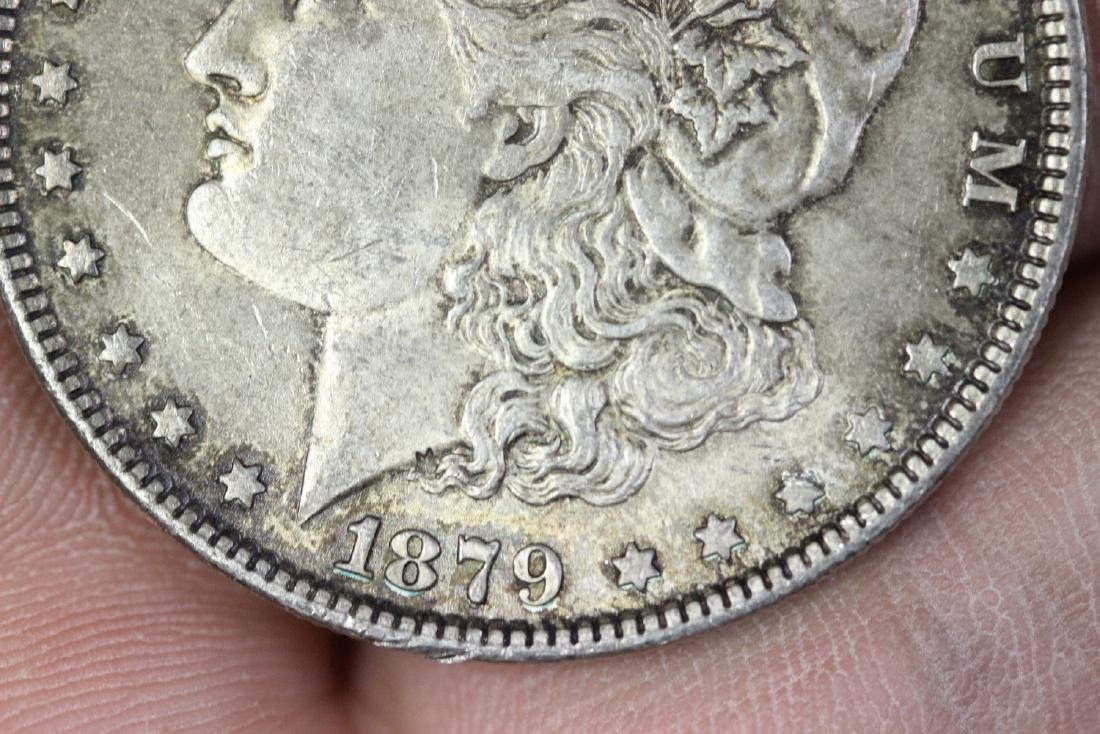 An 1879 Morgan Silver Dollar - 5