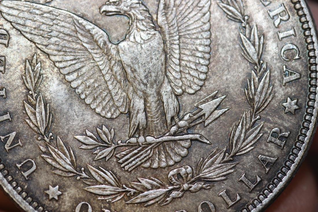 An 1879 Morgan Silver Dollar - 9