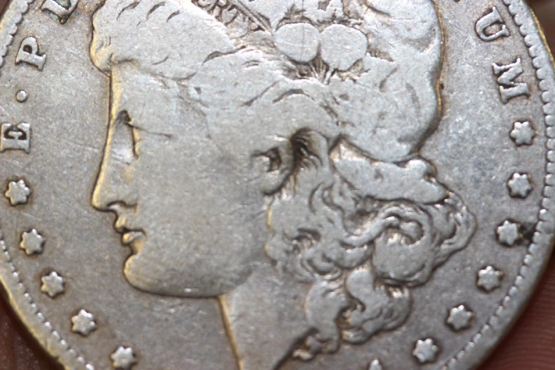 An 1881 Morgan Silver Dollar - 4