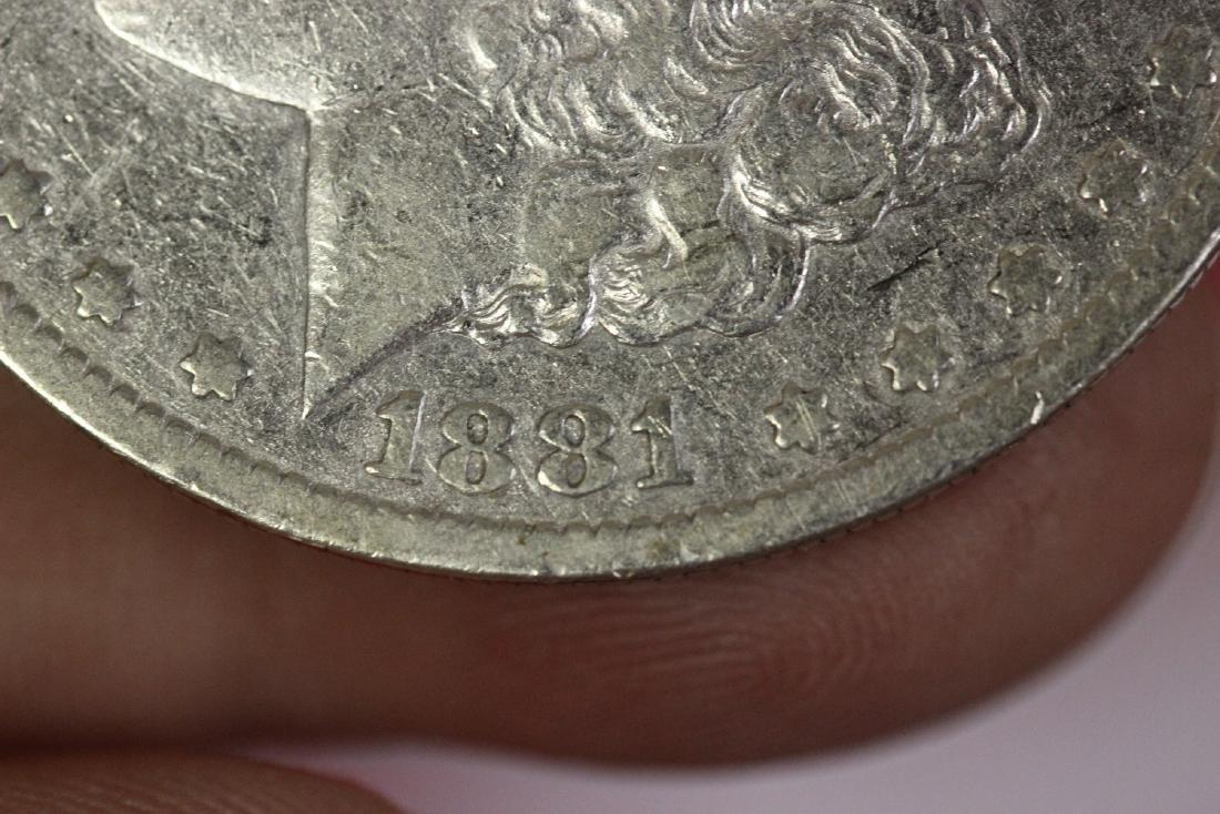 An 1881-s Morgan Silver Dollar - 5