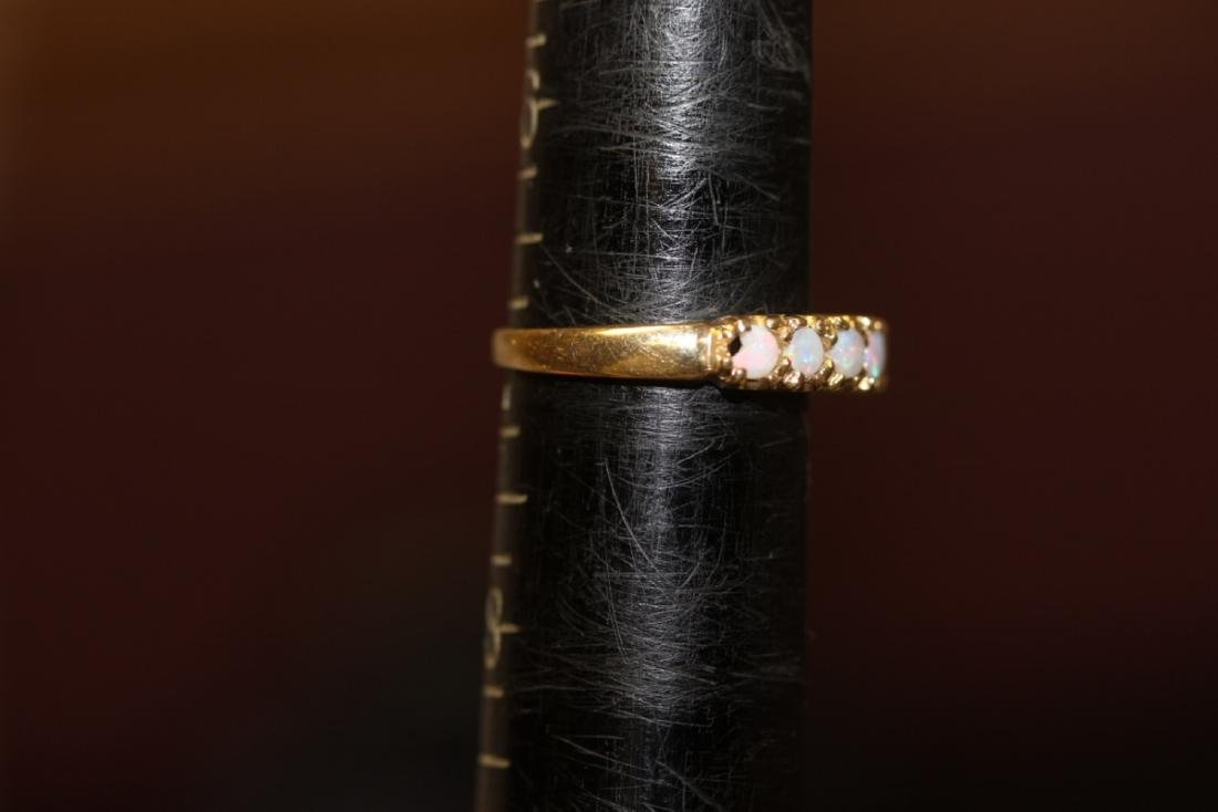A 10Kt Gold and Opal Ring - 5