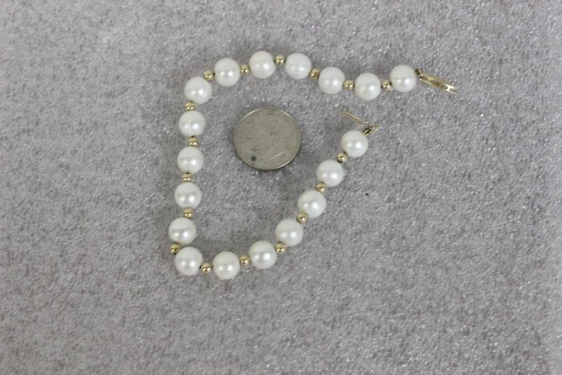 A Marked 585 or 14Kt Gold Clasp and Pearl Bracelet - 5