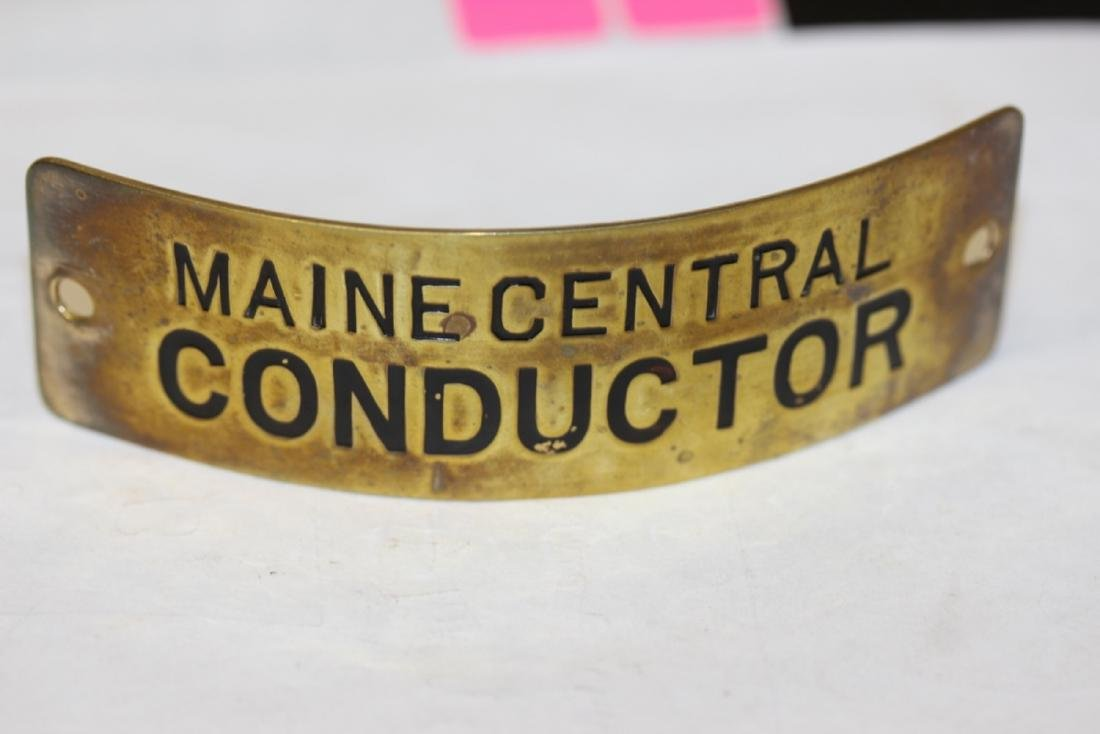 A Vintage Maine Central Conductor Head Badge