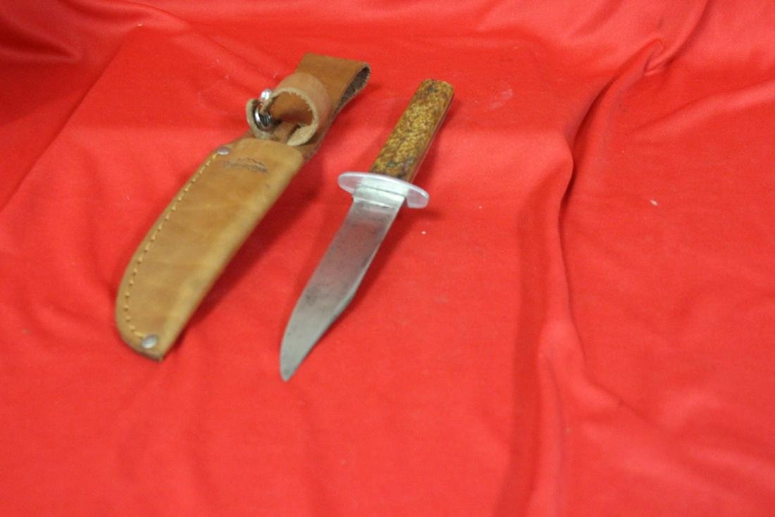 A Hunting Knife with Leather Holder