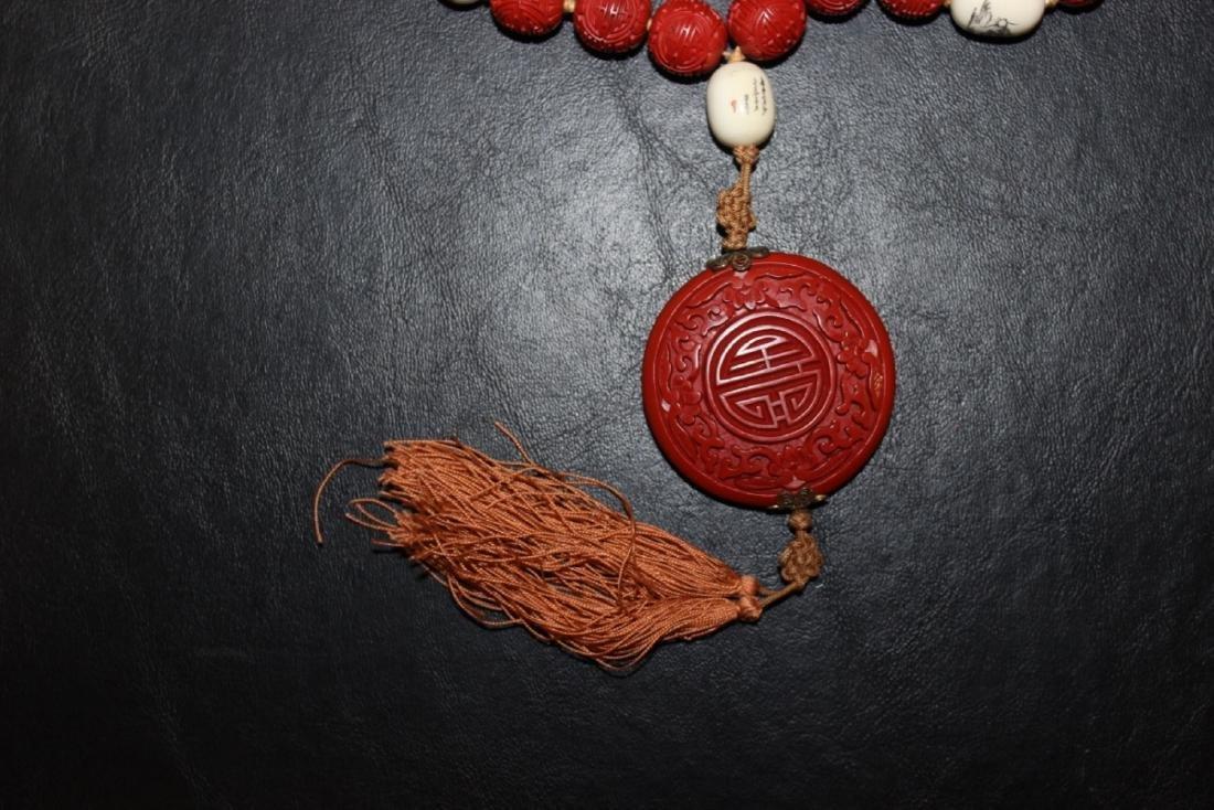 A Cinnabar and Bone Necklace - 2
