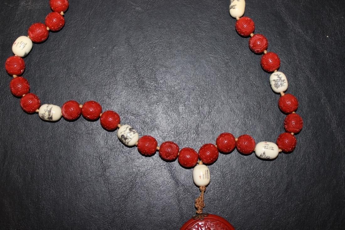 A Cinnabar and Bone Necklace - 3