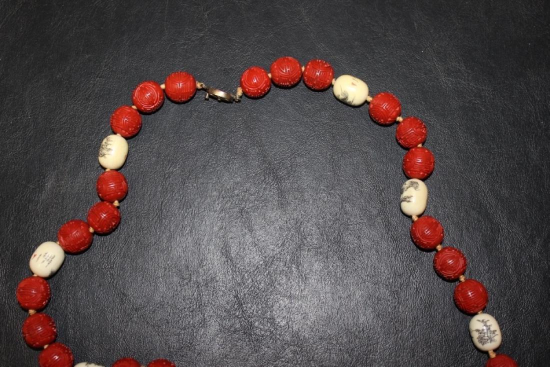 A Cinnabar and Bone Necklace - 4